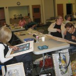 Colorado Columbine members stitch at a meeting.